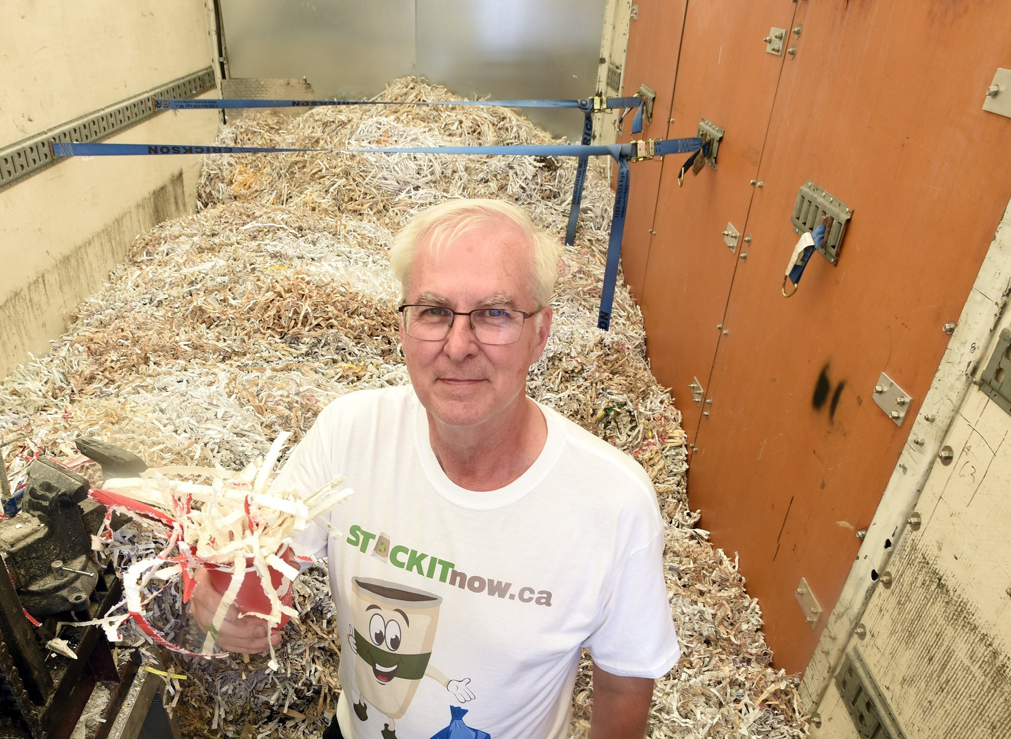 Carbon Neutral Shredding, owner Ian Chandler, in his truck with shredded coffee cups.